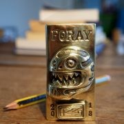 Handcrafted brass emblem for the FORAY.